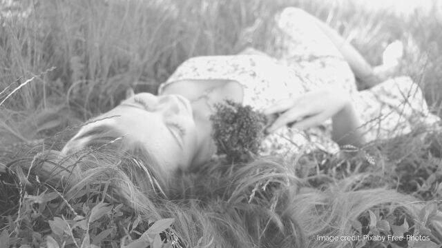 Photo: woman relaxing in a field